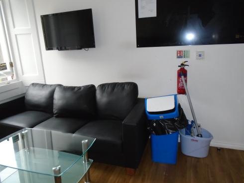 James Craig Court sofa underneath TV in kitchen with no soap, Edinburgh