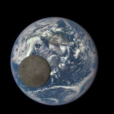 Moon in front of earth photo